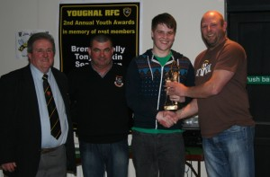 2nd IV Captain Ivan O'Flynn presents Young Player of the Year Award to Tadg Brophy