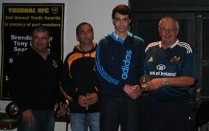 Padjoe Terry presents the Jim Hogan Award to Cathal Dean